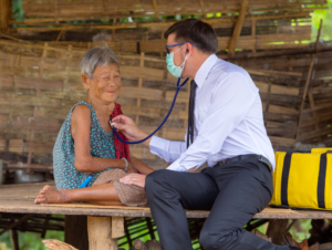 Doctor attending to an elderly woman